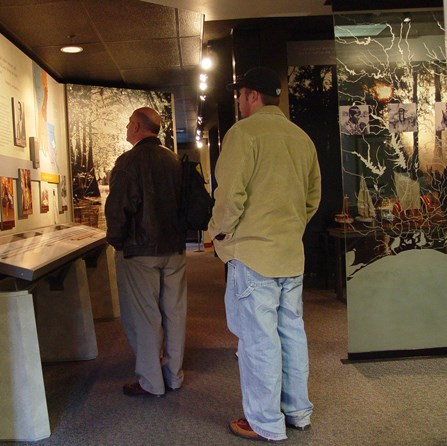 Image of men looking at exhibits