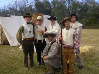 Image of young men dressed as Tennessee volunteers at the 1815 Battle of New Orleans