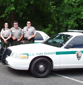 Law enforcement rangers and their car