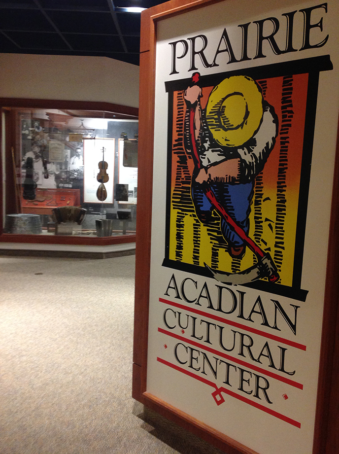 Entry to Prairie Acadian Cultural Center with logo and exhibits