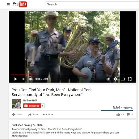 A screen capture of a YouTube video featuring uniformed park rangers singing and playing the tuba and trumpet