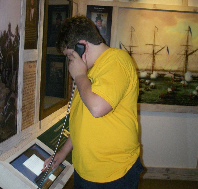 Image of boy at computer interactive exhibit in Chalmette Battlefield Visitor Center