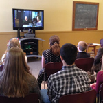 Students in Kansas participate in the Presidents' Day Celebration via live stream.