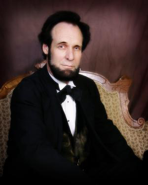 Dennis Boggs as Abraham Lincoln.
