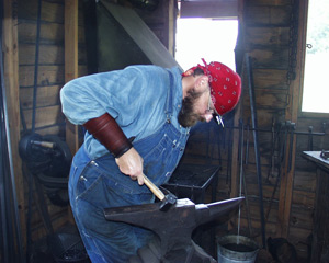 Park Ranger Kevin Alexander blacksmiths at the Boyhood Farm.