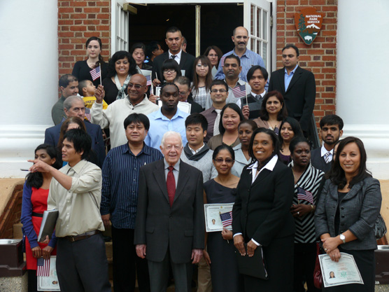 President Carter with new citizens.