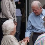 President Carter greeting a visitor on a visit to the Boyhood Farm