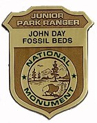 Junior Ranger gold badge for John Day Fossil Beds National Monument