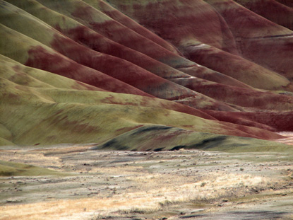 Image of the Painted Hills, zoomed in with sun raking across the foreground.
