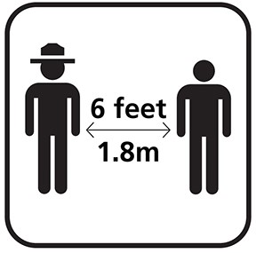 A silhouette of a park ranger and a person standing 6 feet or 1.8 meters apart