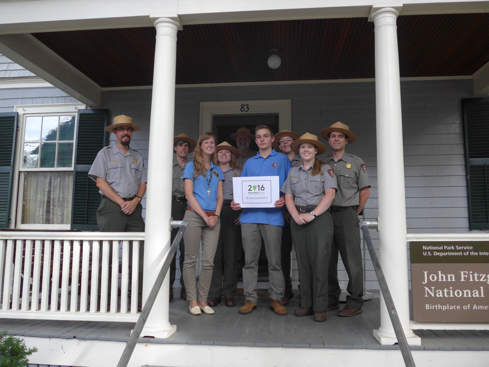 Rangers, volunteers and interns stand in front of JFK's birthplace