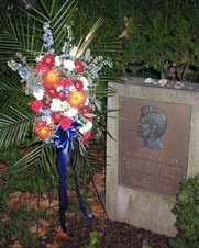 JFK Memorial wreath and stones left at a commemoration marker in front of the house where he was born