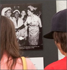 Visitors looking at a photograph of Mrs. Rose Kennedy taken during a 1952 campaign tea.