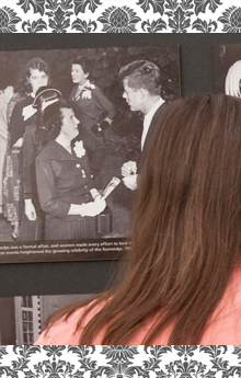 A women looks at a photograph of a receiving line from a Kennedy campaign tea.