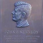 "The town of Brookline placed this bronze, bas-relief plaque in the front yard of 83 Beals Street in 1961 to recognize the birthplace of the newly elected president.  Below a portrait of Kennedy, the text reads: ""Birthplace of John F. Kennedy  35th President of the United States  Born May 29, 1917 on this site  83 Beals St., Brookline, Mass"""