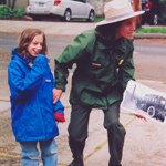 A ranger and child participating in the Junior Ranger Program