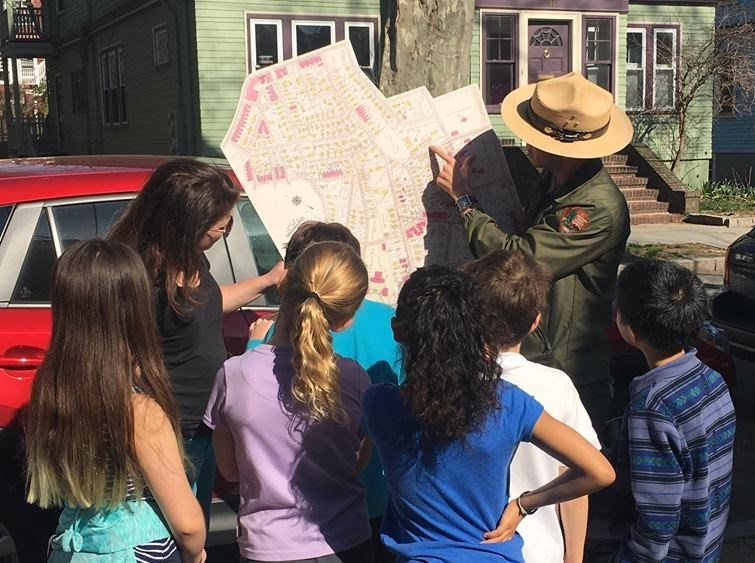 Ranger Jason identifies places that were special to the Kennedy Family on a map of Brookline.