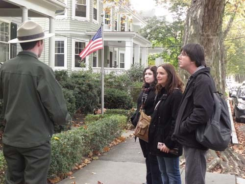 a park ranger explains to visitors how to keep themselves safe in our neighborhood.