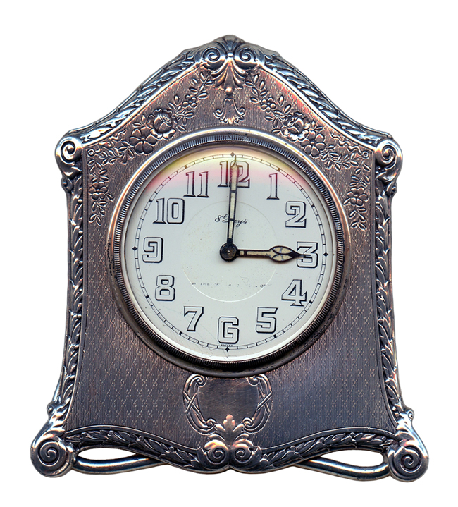 A silver clock by the Concord Watch Company of Switzerland.