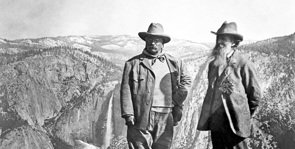 John Muir and President Roosevelt standing on a mountain at Yosemite.