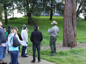 Ranger speaks to visitors next to the great Sequoia Tree.