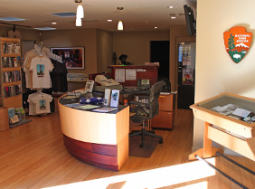 Image of the Visitor Center front desk and NPS shield.