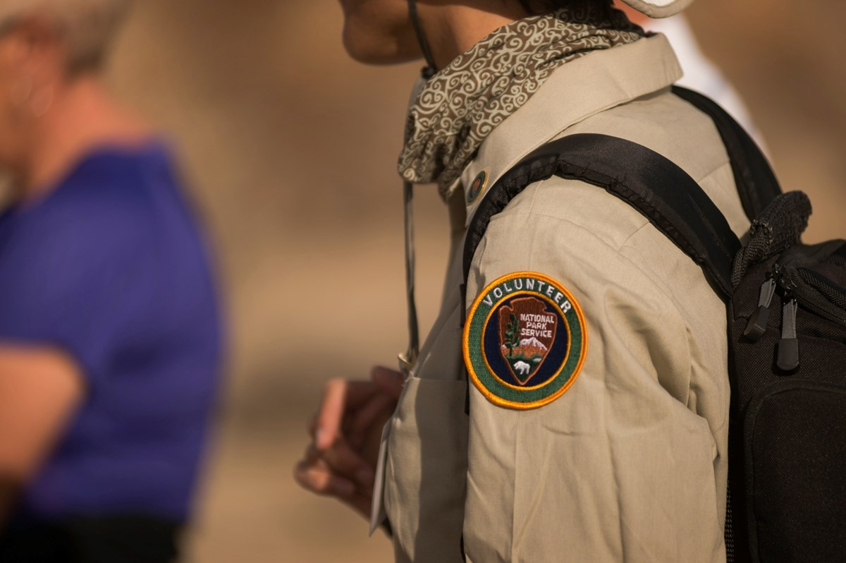Close-up of a volunteer patch on the arm of a tan shirt. Photo: NPS / Kurt Moses