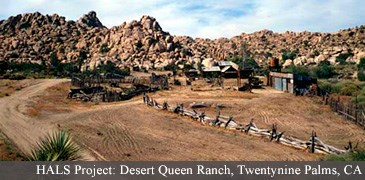 desert scene with fenceline and historic buildings