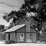 Black and white photo of the Oasis of Mara cabin.