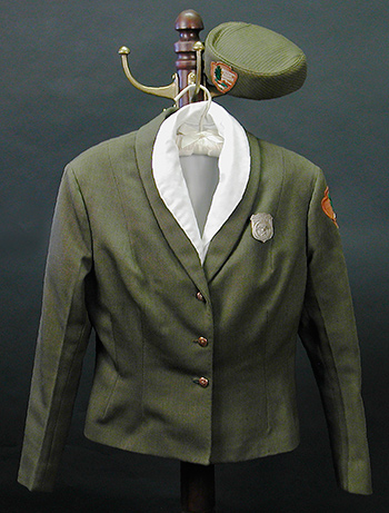 vintage ranger uniform pieces hanging on a coatrack