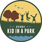 circular graphic showing kids playing in a field and the words EVERY KID IN A PARK