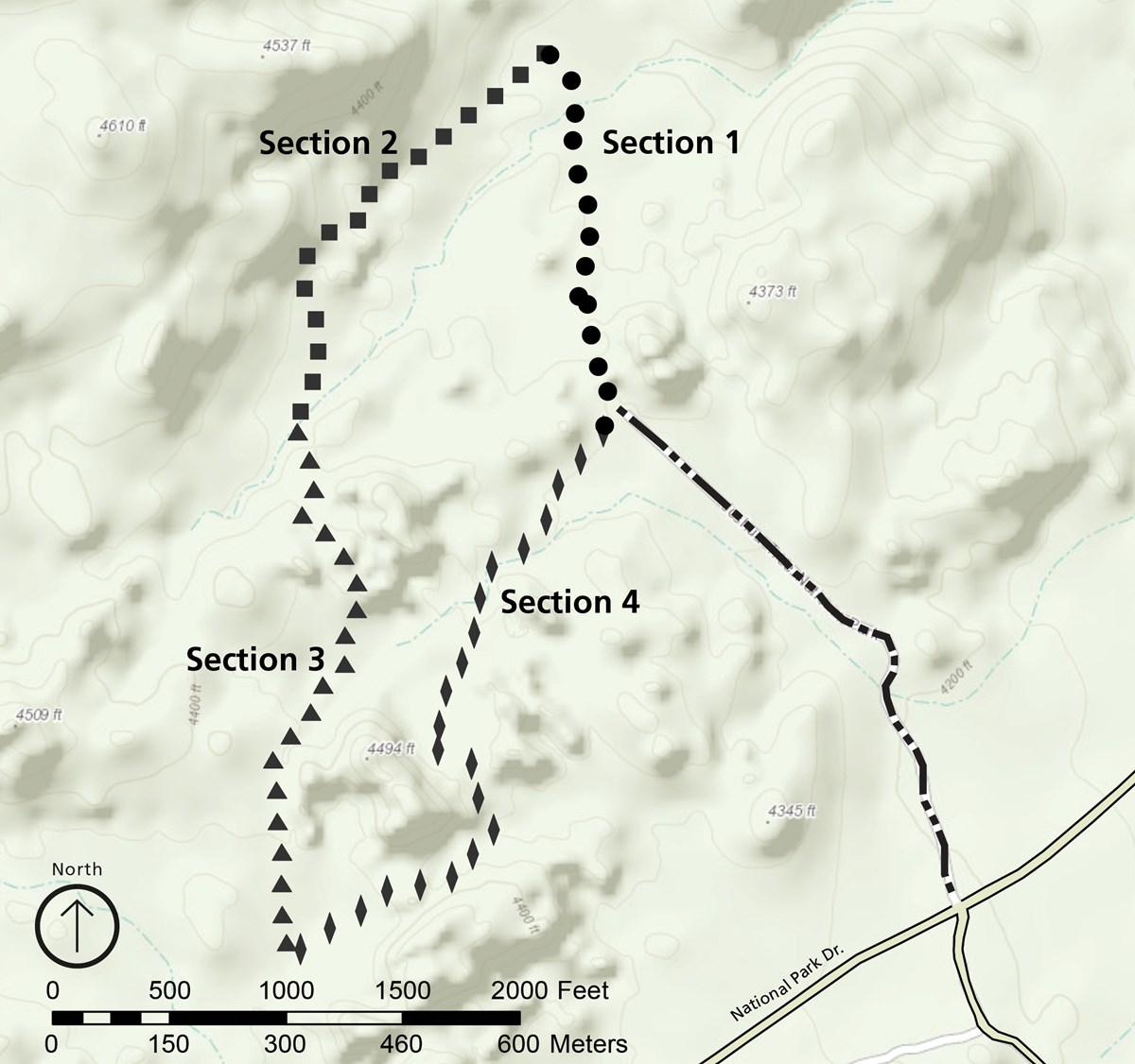 Map of the Split Rock area. The trail makes a loop, with a spur that goes to the road. Starting from where the spur meets the loop, at approximately 3 o'clock on a clock face, the trail moves counter-clockwise through sections 1-4, each 1/4 of the total.