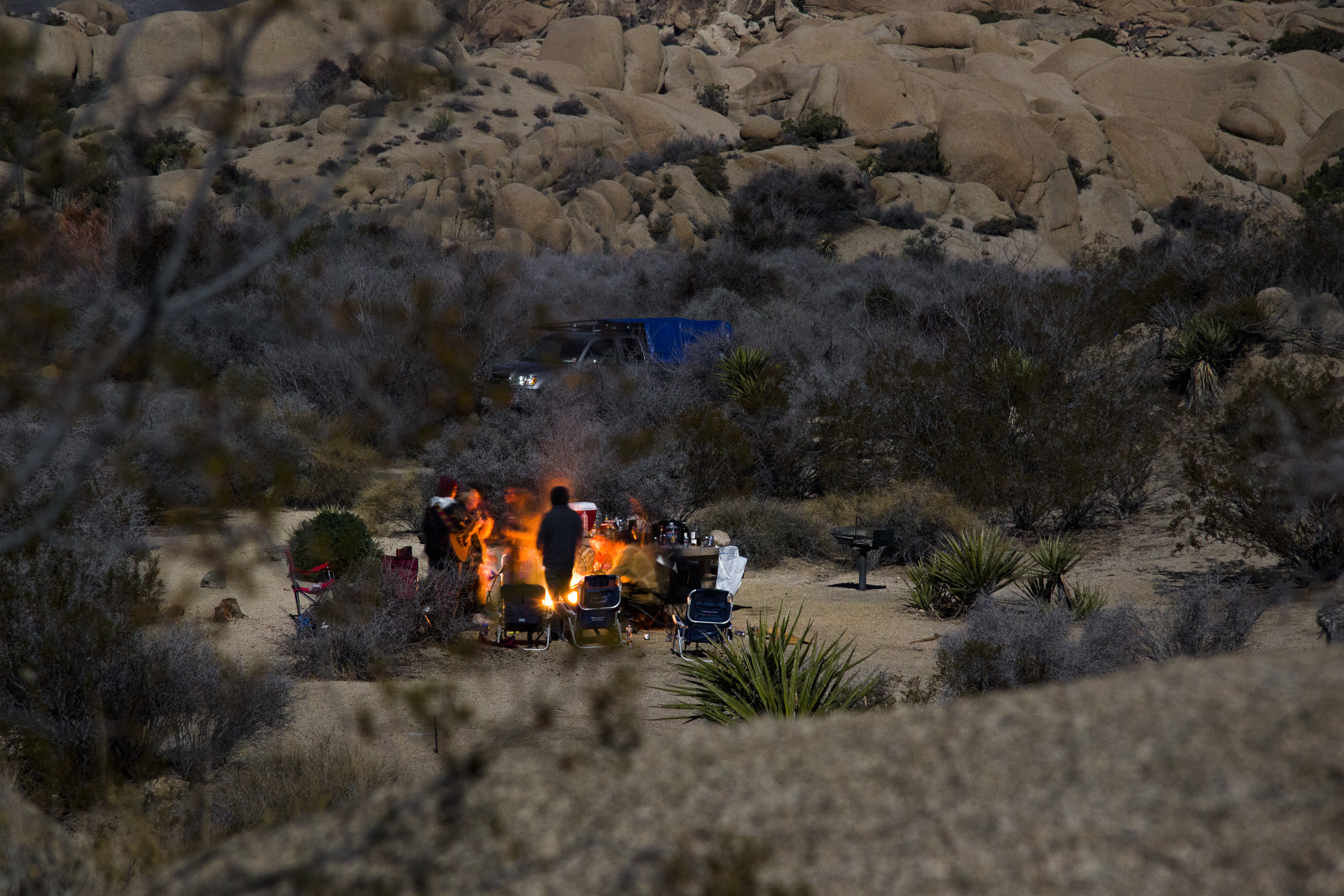 Campers gather around the fire ring at the Jumbo Rocks Campground. NPS / Brad Sutton