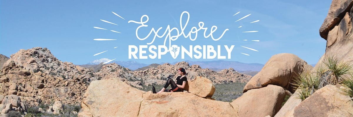 "color photo of a clear blue sky over a boulder pile landscape with a single woman reclined on a rock looking out across the landscape; graphic overlay text reads ""Explore Responsibly"" in a mix of script and block letters"