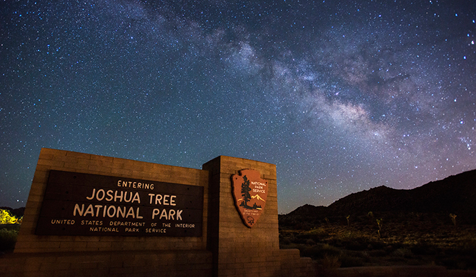 starry sky over Joshua Tree National Park entrance sign