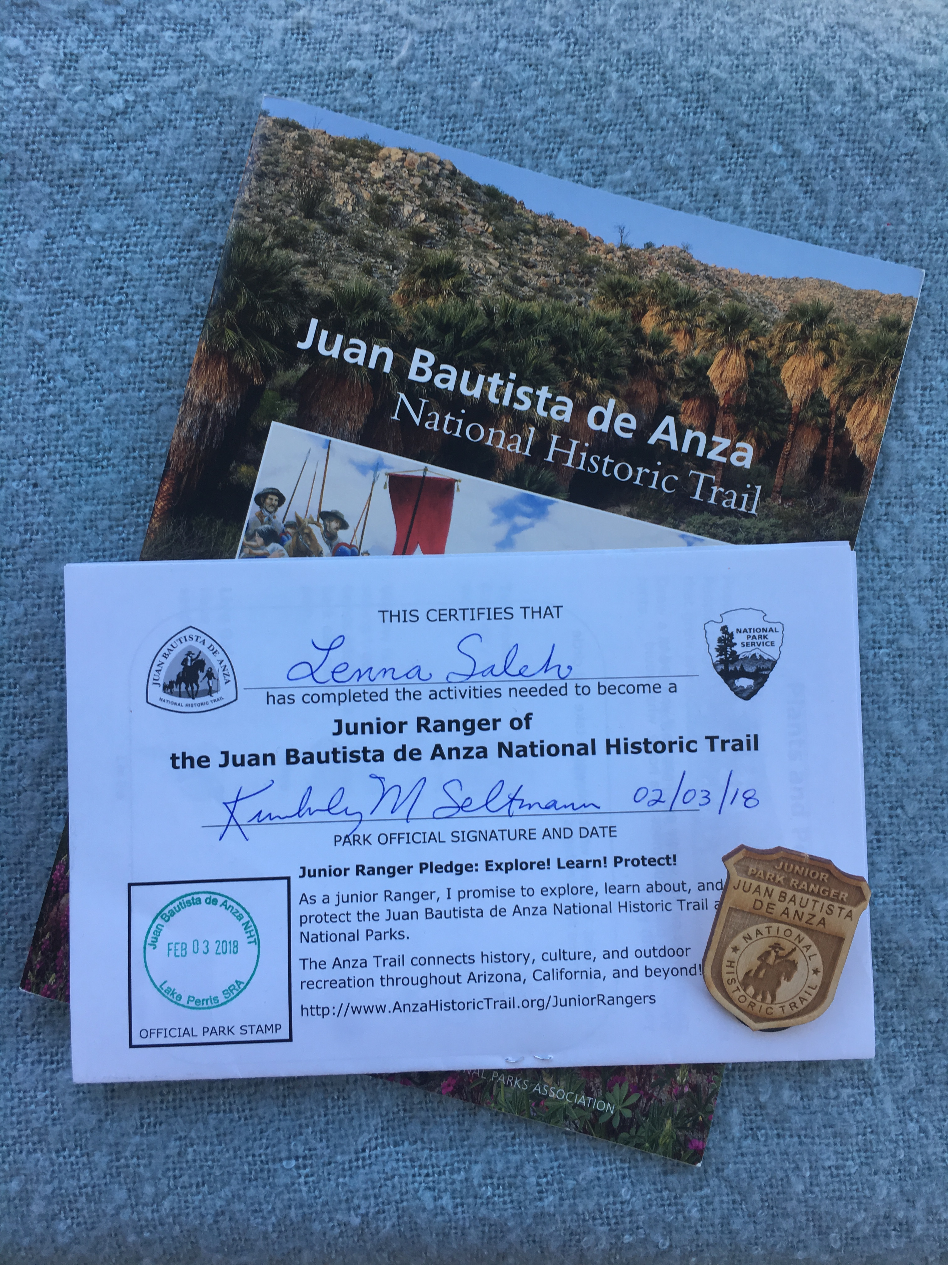 A complete junior ranger certificate, badge, and book about the Anza Trail.