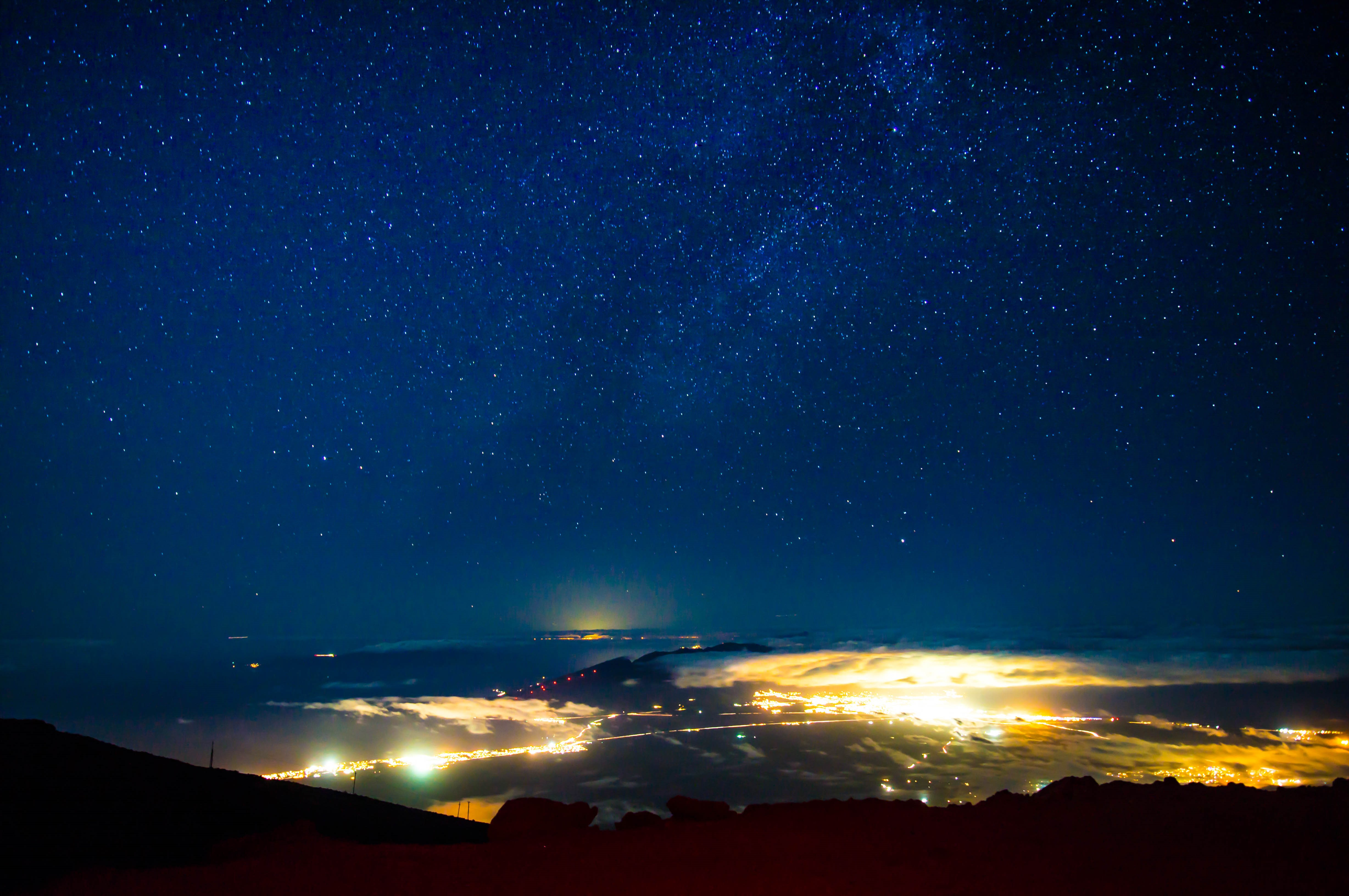 Bright Stars In A Cobalt Blue Night Sky Over The City Of Maui