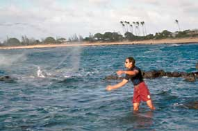 A throw-net fisherman at Kalaupapa.