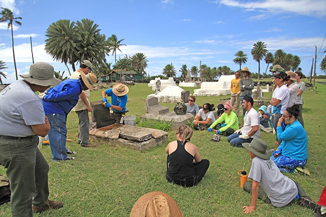 Workshop participants at Papaloa Cemetery during a field session.