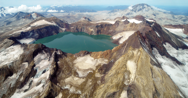 Several thousand feet of Mount Katmai collapsed when magma was drained from underneath it. A deep lake now fills most of the caldera.