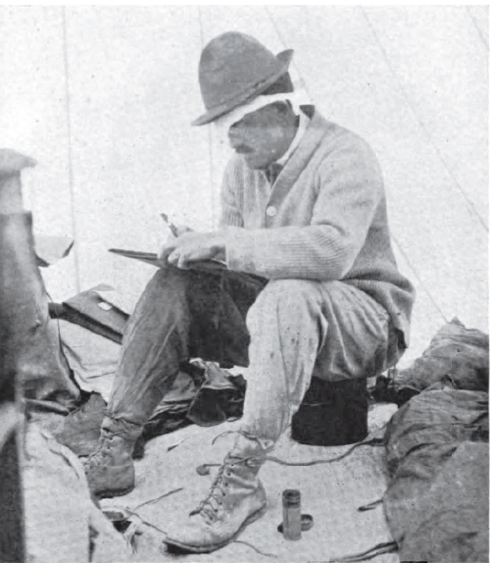Griggs wearing a bandage on eye and sitting inside tent