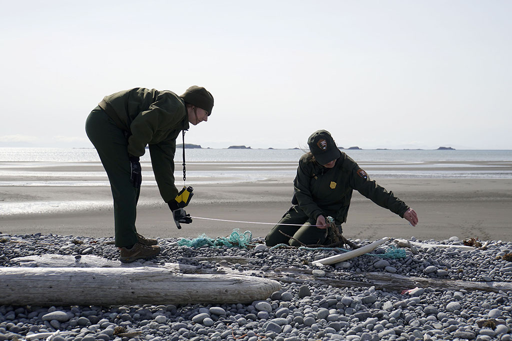 Rangers Kelsey and Carissa measure debris for the Marine Debris Survey. NPS Photo/Kaitlyn Kunce