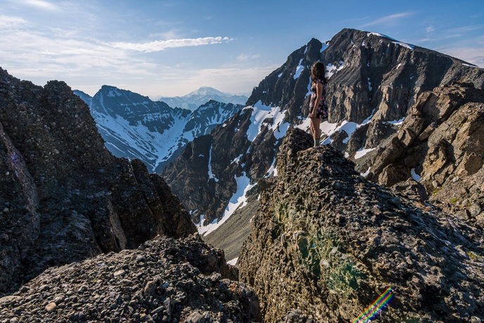 Woman standing on a rugged mountain ridge