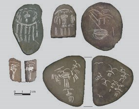 Incised pebbles are thought to be either game pieces or ritual items.