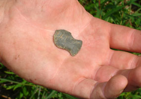 This side notched projectile point has an impact fracture at the tip.