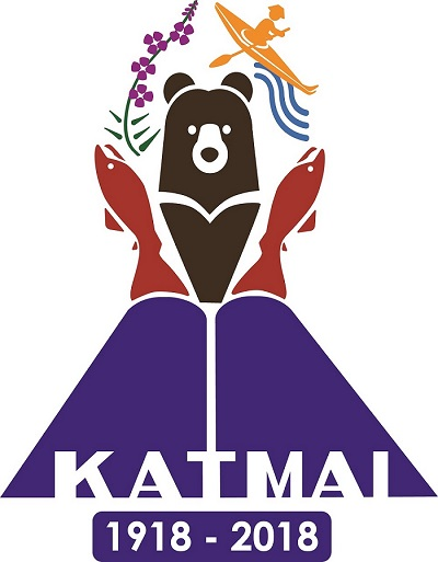 Katmai's centennial logo: purple flowers, red salmon, and a traditional kayaker on a river surround a brown bear on top of a volcano with the text katmai 1918-2018