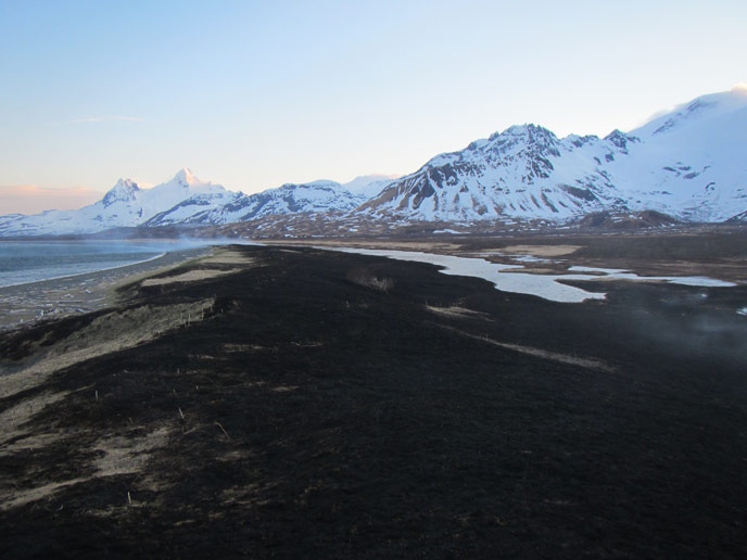 snowy mountains, brown plain and scorched area