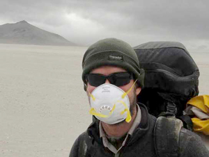 A-hiker-protects-himself-from-blowing-volcanic-ash
