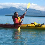 A kayaker enjoys her time on Naknek Lake.