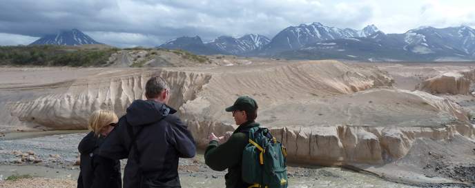 A ranger leads visitors on the Valley of Ten Thousand Smokes Tour